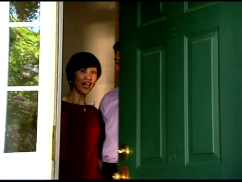 couple smiling and opening door - answering stock videos & royalty-free footage