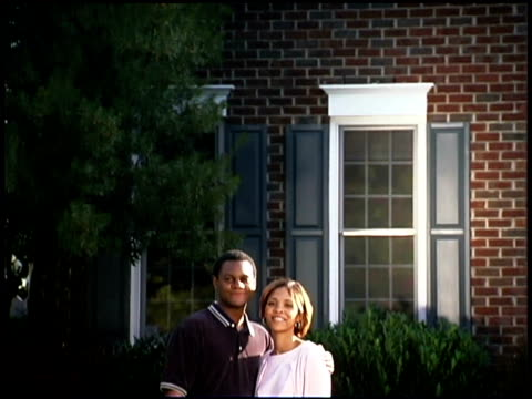 couple smiling by new home - hinweisschild stock-videos und b-roll-filmmaterial