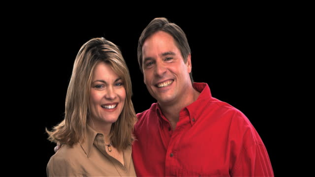 couple smiling close-up - this clip has an embedded alpha-channel - keyable stock videos & royalty-free footage