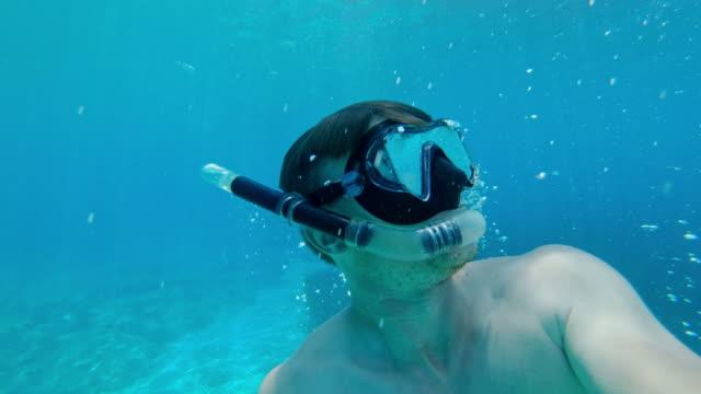 ms couple snorkeling in sunny blue ocean,adriatic sea,croatia - underwater stock videos & royalty-free footage