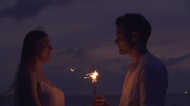 Couple Sparkler Celebration Happiness Togetherness Concept.Honeymoon concept.
