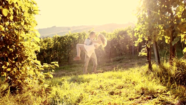 SLO MO Couple spinning in the vineyard