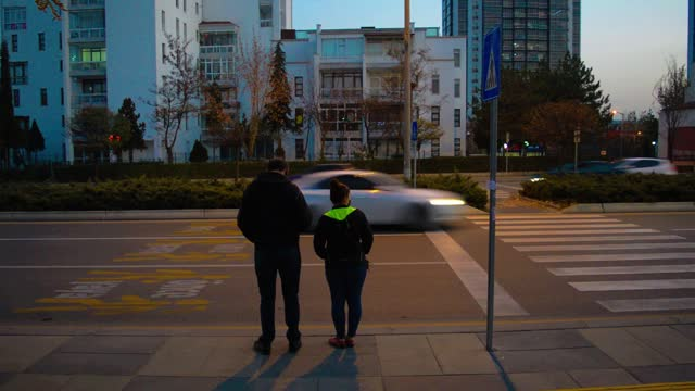 couple stand next to a road as vehicles are driven along a street ahead of a partial weekday curfew on december 2, 2020 in ankara, turkey. turkey... - weekday stock videos & royalty-free footage