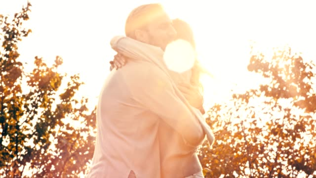 couple standing face to face outdoors - mid adult couple stock videos & royalty-free footage