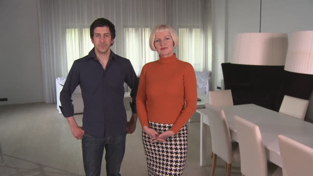 ws zi portrait couple standing in modern apartment/ zo couple/ berlin, germany - polo neck stock videos & royalty-free footage