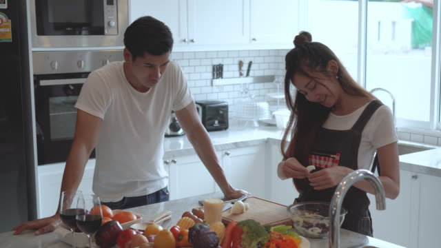 Couple sweet cooking together at home.