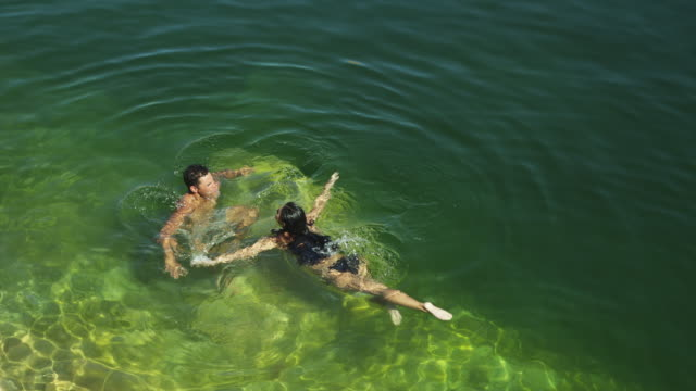 ws ha couple swimming in lake powell / utah, usa - lake powell stock videos and b-roll footage