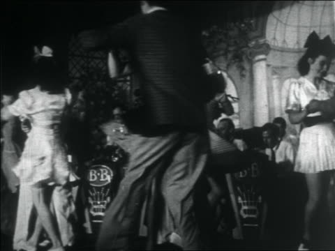 vidéos et rushes de b/w 1938 couple swing dancing / big band in background / documentary - rock