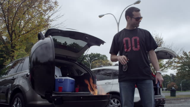 couple tailgating with barbecue - beer bottle stock videos & royalty-free footage