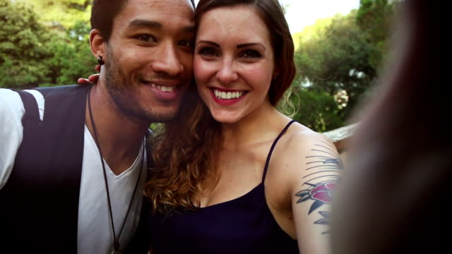 couple taking a selfie with intimacy - tattoo stock videos & royalty-free footage