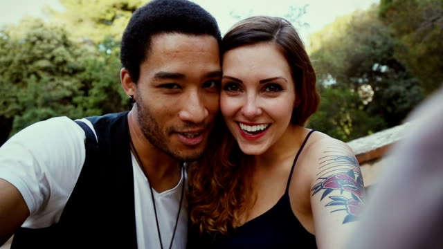 couple taking a selfie with intimacy - multiracial group stock videos & royalty-free footage