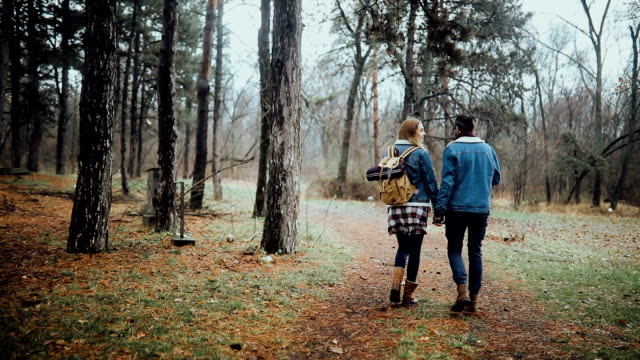 Couple taking a stroll in the forest