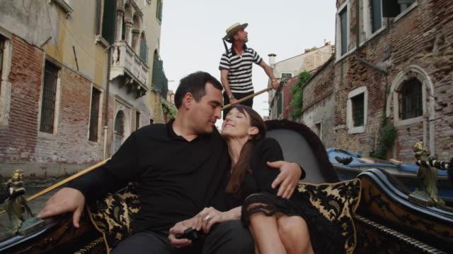 MS Couple taking photos traveling in gondola / Venice,Veneto