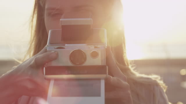 couple taking photos - polaroid stock videos & royalty-free footage
