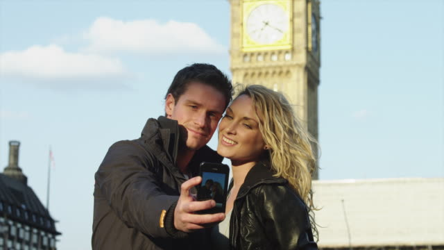 MS Couple taking self photo in front of Big Ben / London, UK