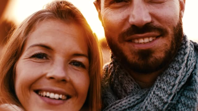 Couple taking selfie, close-up on faces