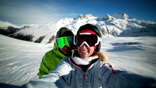 Couple taking selfie on ski slope