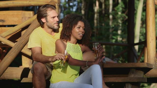 vídeos de stock e filmes b-roll de ms a couple talk and laugh together / maringa, brazil - homens de idade mediana
