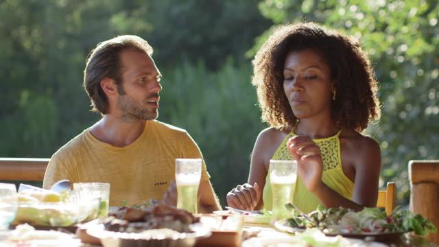 MS A couple talk while eating outside together / Maringa, Brazil
