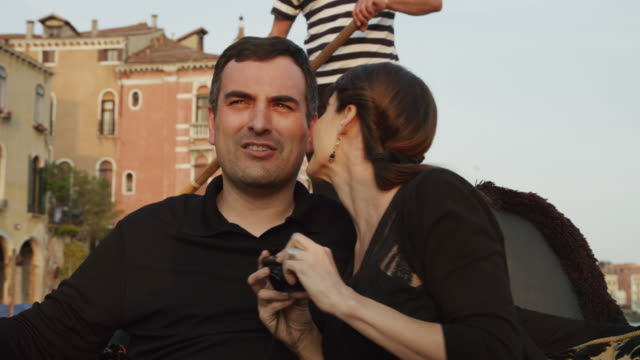 CU Couple talking and embracing traveling in gondola / Venice,Veneto