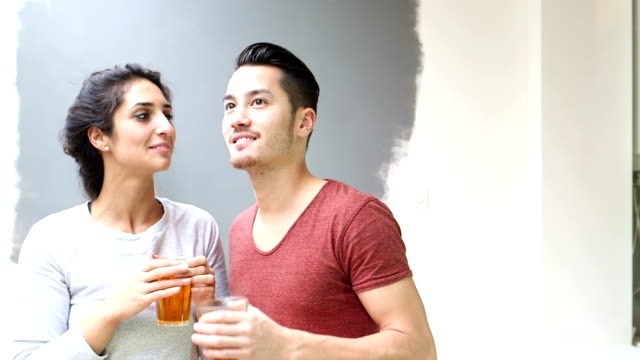 Couple talking and laughing while drinking tea