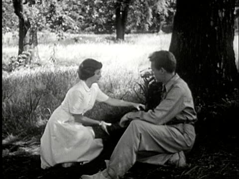 ms, b/w, composite, couple talking and setting up picnic by tree, usa - falling in love stock videos and b-roll footage