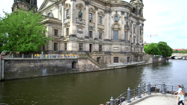 Couple talking and standing near Berlin Cathedral, Berlin, Germany