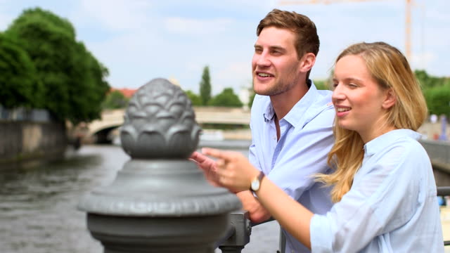 couple talking and standing near spree river - wristwatch stock videos and b-roll footage