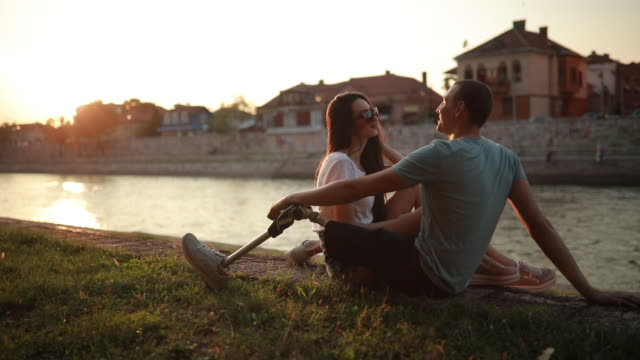 couple talking by the river - amputee stock videos & royalty-free footage