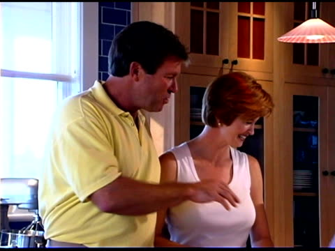 couple talking in kitchen - see other clips from this shoot 1335 stock videos and b-roll footage