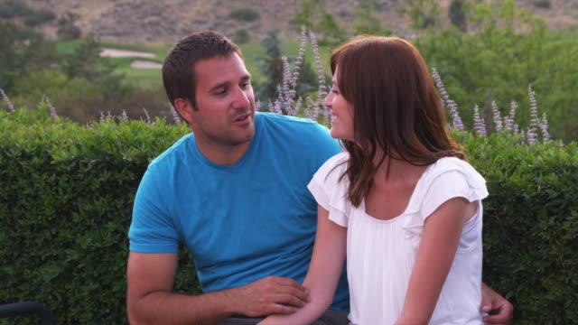 SLO MO MS Couple talking in park / Utah, USA