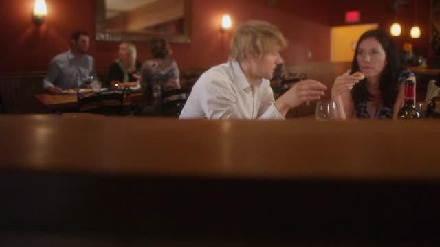 MS Couple talking in restaurant / Squamish, British Columbia, Canada