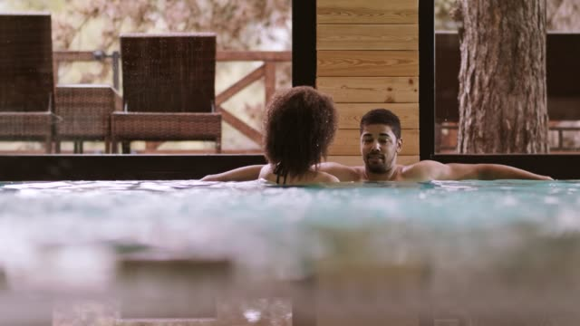 Couple talking in spa pool