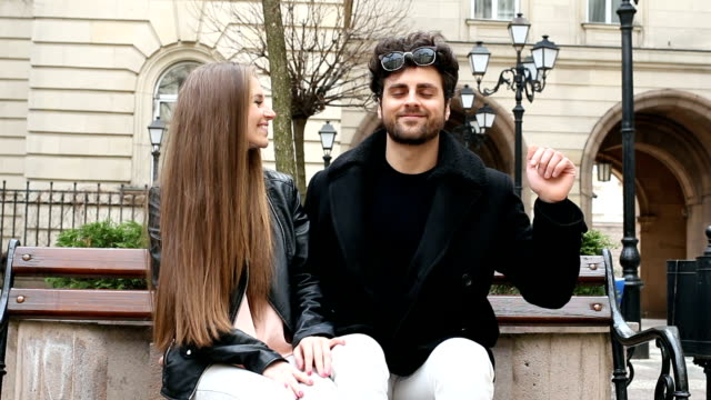 couple talking on a bench - teasing stock videos & royalty-free footage