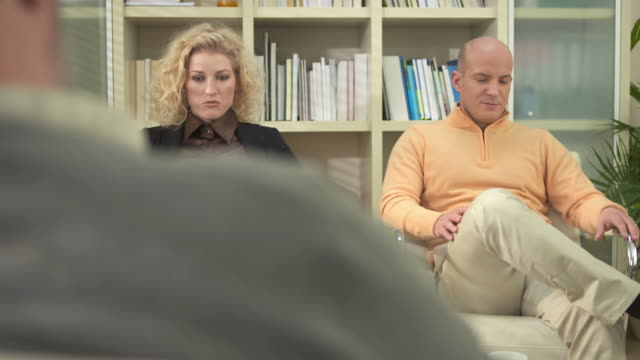 hd dolly: couple talking to counselor - mental health professional stock videos and b-roll footage