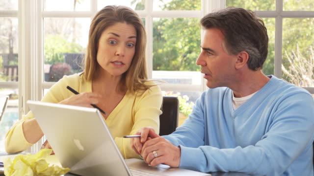 ms couple talking using laptop sitting at table, phoenix, arizona, usa - rolling eyes stock videos & royalty-free footage