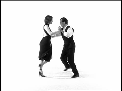 b/w overexposed couple tango dancing on white surface in studio - tango dance stock videos and b-roll footage