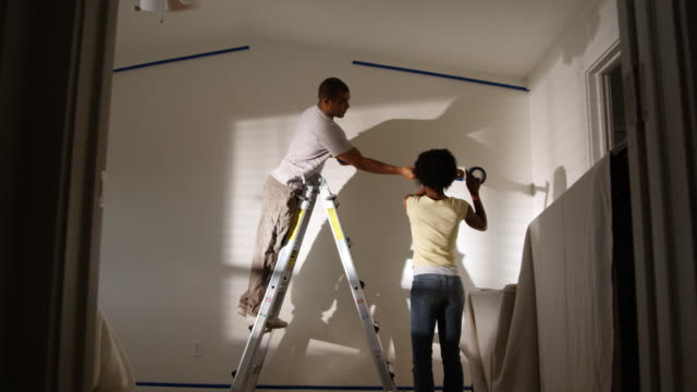 couple taping a room off to paint - see other clips from this shoot 1419 stock videos & royalty-free footage