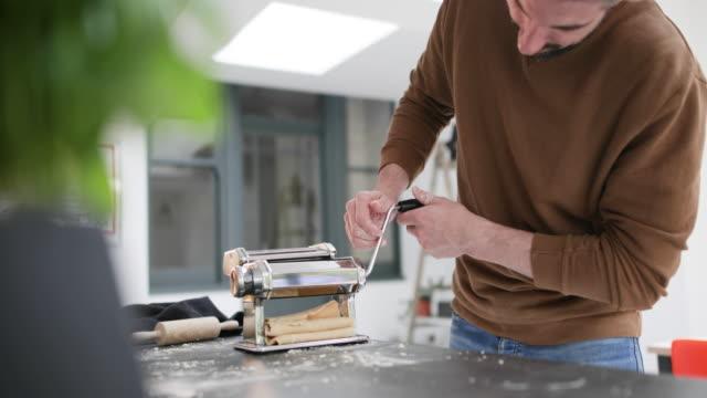 vídeos y material grabado en eventos de stock de couple tasting food whilst cooking - procedimiento