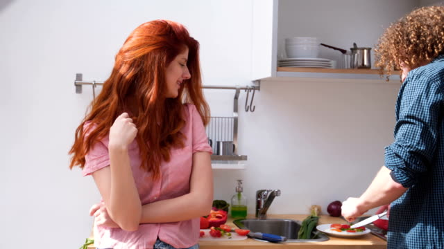 couple tasting self-made food in the kitchen - 25 29 ans stock videos & royalty-free footage