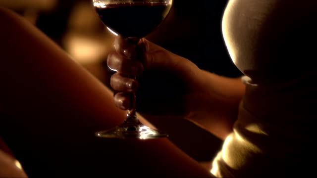 stockvideo's en b-roll-footage met couple toasting by the fireplace - alcohol