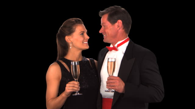 couple toasting champagne and kissing - this clip has an embedded alpha-channel - pre matted stock-videos und b-roll-filmmaterial