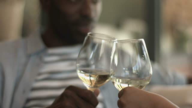 couple toasting wine at home - white wine stock videos & royalty-free footage