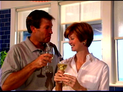couple toasting wine - see other clips from this shoot 1335 stock videos and b-roll footage