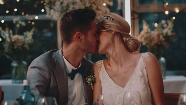couple toasting wineglasses and kissing in wedding - tradition stock videos & royalty-free footage