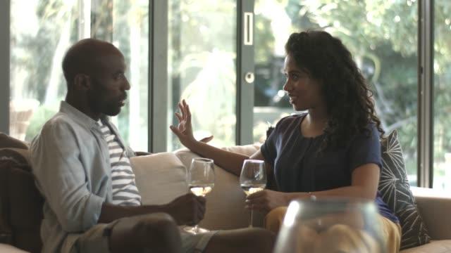 couple toasting wineglasses at home - 妻点の映像素材/bロール