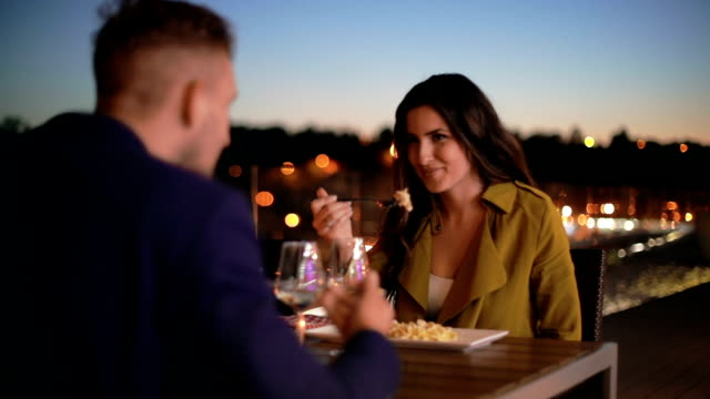 couple toasting wineglasses at restaurant table - restaurant stock videos & royalty-free footage