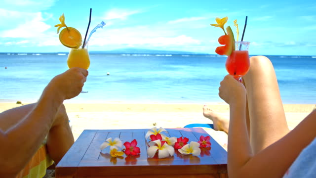 ms couple toasting with cocktails on the beach - refreshment stock videos & royalty-free footage