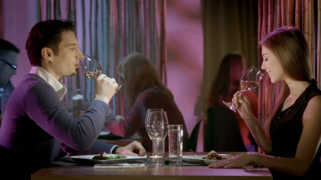 HD: Couple Toasting With Wine In The Restaurant