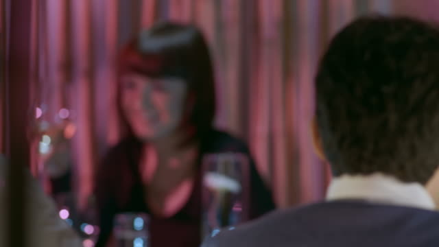 hd dolly: couple toasting with wine in the restaurant - first occurrence stock videos and b-roll footage